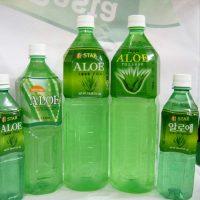 Заготовленный впрок сок в бутылках разного размера